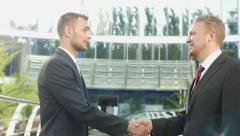 Handshake business men on the background of office building - stock footage