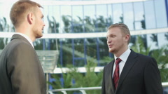Handshake business men on the background of office building Stock Footage
