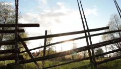 Slider shot of wooden fence and landscape Stock Footage