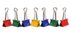 Color binder clips on white background - stock photo