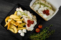 Delicious portion of rustic potatoes fillet with aromatic herbs Stock Photos