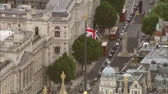Aerial London - Union Flag on top of Houses of Parliament with Whitehall in B - stock footage