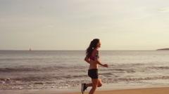 Woman Running on Beach Stock Footage