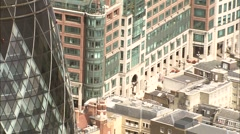 Aerial London - CU flypast of St Mary Axe (The Gherkin) Stock Footage