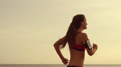 Woman Running in Slow Motion Listening to Music Stock Footage