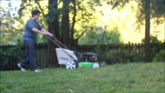 blurred lawn mowed sunset in trees - stock footage