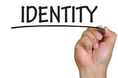 Stock Photo of hand writing identity