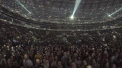 Illumination spots moving on ceiling, light flashing. Crowd enjoying concert Stock Footage