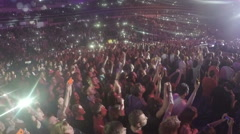 Fans enjoying popular love song at concert, waving mobile phones in air slowly Stock Footage