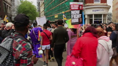 Birmingham Gay Pride - people marching in the parade - slow motion Stock Footage