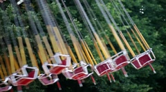 Carousel swings in amusement park Stock Footage