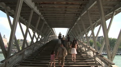 People Along the Passerelle Leopold-Sedar-Senghor 1 Stock Footage