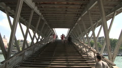 People Along the Passerelle Leopold-Sedar-Senghor 2 Stock Footage
