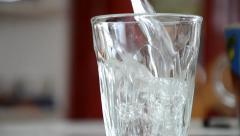 Flavored mineral water pouring into a glass Stock Footage