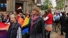 Birmingham Gay Pride-people holding rainbow flag and cheering South Asians LGBT Stock Footage