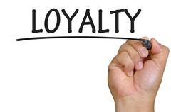 Hand writing loyalty Stock Photos