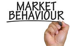 Hand writing market behaviour Stock Photos