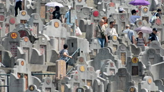 Time Lapse of Crowded Hong Kong Cemetery with Chinese Inscribed Headstones Stock Footage