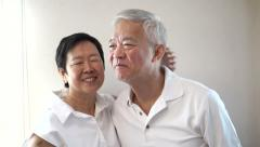 Happy Asian senior couple on white background. Laughing and talking Stock Footage