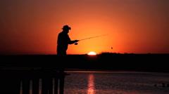 Fisherman at sunrise time. Brazil, Mato Grosso, Pantanal Stock Footage