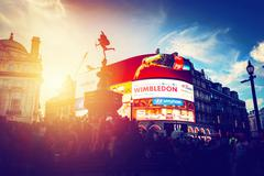 Piccadilly Circus neon ads glow at sunset, young night. London, UK. - stock photo