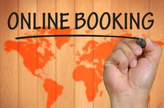 Hand writing online booking Stock Photos