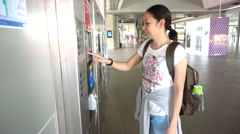 Girl tourist buying subway or train tickets at the ticket machine Stock Footage