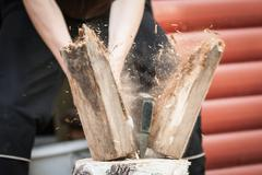 Wood chopping with hand axe - stock photo