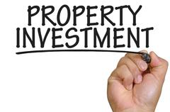 Hand writing property investment Stock Photos