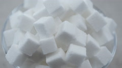 Above shot of a pile of white sugar cubes in a glass bowl Stock Footage