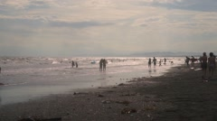 Slow motion footage of people on the beach at sunset in Enoshima, Kanagawa Stock Footage