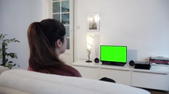 Girl Watching Green Screen Television - Full HD Stock Footage