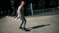 Skater performing stunts in a skatepark - stock footage