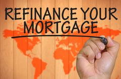 hand writing refinance your mortgage - stock photo