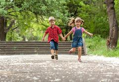 Stock Photo of Happiness brother and sister fun outdoor under sunlight