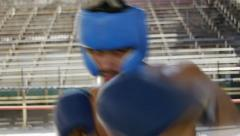 Hispanic man training in boxing gym athlete boxe combat sport Stock Footage
