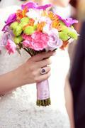 Bride holding her wedding bouquet - stock photo