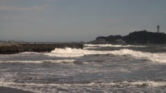 Slow motion footage of waves crashing on the barriers in Enoshima beach, Stock Footage