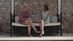 Women sitting on sofa Stock Footage