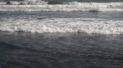 Slow motion footage of waves crashing on the shore in Enoshima, Kanagawa Stock Footage