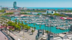 4K UltraHD Barcelona aerial view, Port Vell yachts and Barceloneta buildings Stock Footage
