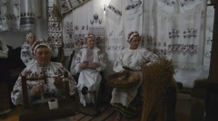Women in Ethnic Clothing Singing Folk Song and Doing Traditional Crafts. Ukraine Stock Footage