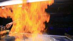 Open fire in a restaurant Stock Footage