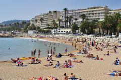 Public beach in the Promenade de la Croisette in Cannes, France Stock Photos