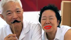 Happy senior asian couple playing and have fun with humour Arkistovideo