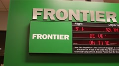 Editorial frontier airport sign with information panning shot - stock footage