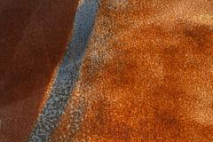 Vintage vivid rust stained corroded metal surface - stock photo
