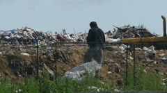 Bum at the dump Stock Footage