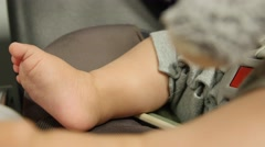 Babys feet in his car seat - stock footage
