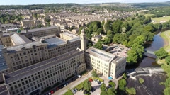 Aerial shot of Salts Mill, Saltaire Unesco site, Bradford, Wes Yorkshire, UK Stock Footage